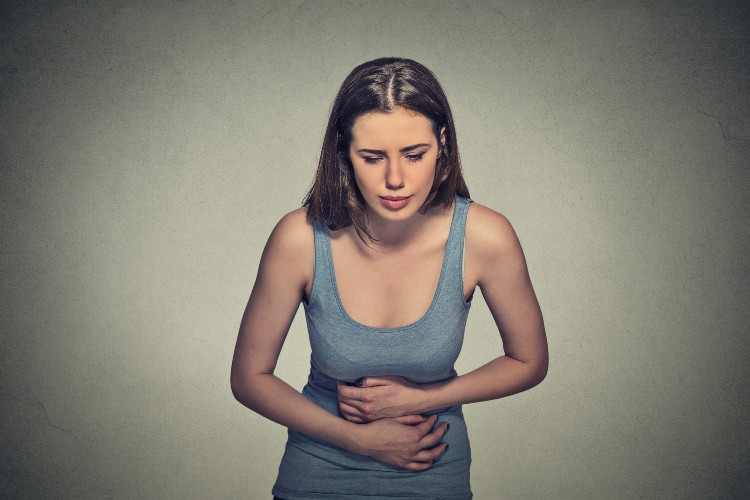 """More often than not, we experience unexplained bloating, irritable bowel syndrome, cramps and generally dub it as a """"weak"""" or """"problematic"""" stomach. Image source: Shutterstock."""
