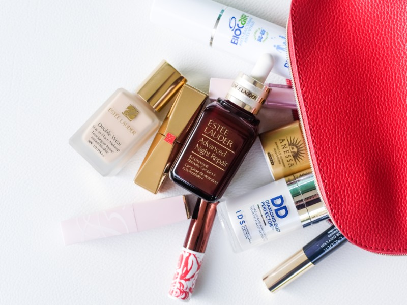 A glimpse into Joanne Peh's vanity bag — amidst a Biocair hand disinfectant, the Japanese sunscreen brand, Anessa's perfect UV sunscreen mild milk, and IDS's Diamond-Dust Perfector Makeup Base is Estée Lauder's Advanced Night Repair. Photograph by Sng Ler Jun.
