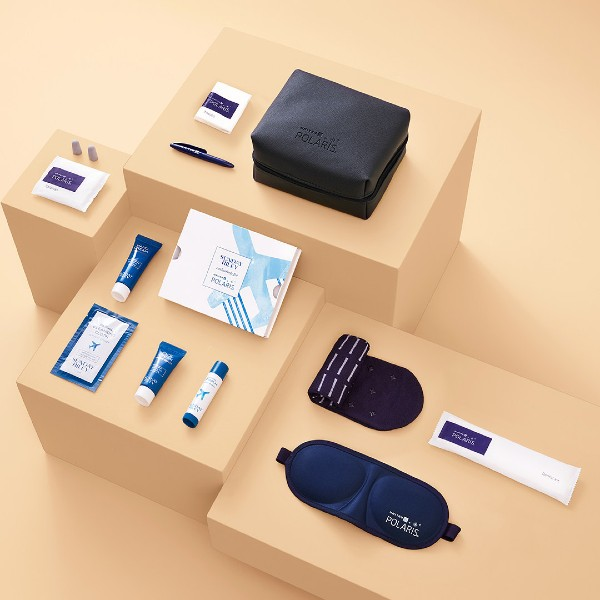 A glance at United Airlines' updated in-flight amenity kit, complete with Sunday Riley products. Image source: United Airlines.