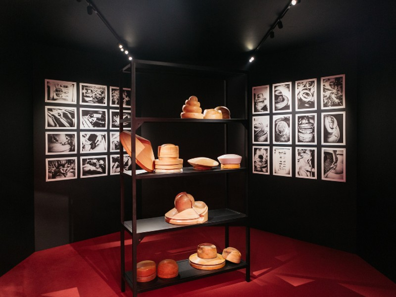 Wooden mock-ups of hats from the milliners, Maison Michel, on display. Image courtesy of Chanel