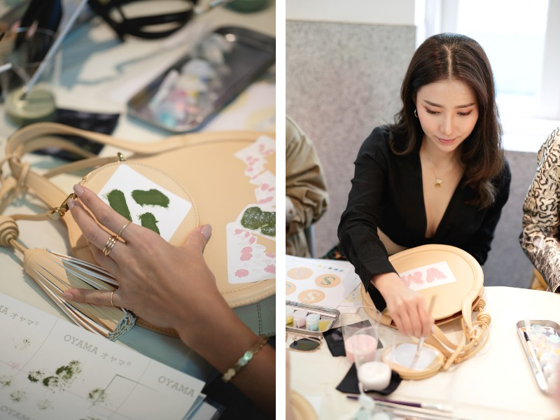 Attendees brushed acrylic paint over stick-on stencils. On the right, Venice Min printed her initials on her bag. Image courtesy of Charles & Keith.