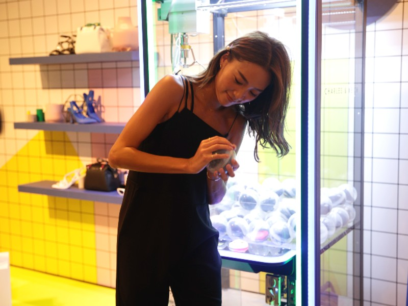 Fellow Japanese Instagrammer, Tan Catherine Nakashima (@kathy_tan529), trying to crack open the ball she won from the Charles & Keith claw machine. Image courtesy of Charles & Keith.