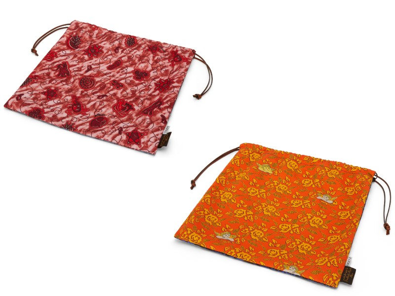 From left: a printed, large drawstring pouch in red (S$490); a printed, large drawstring pouch in orange (S$490).