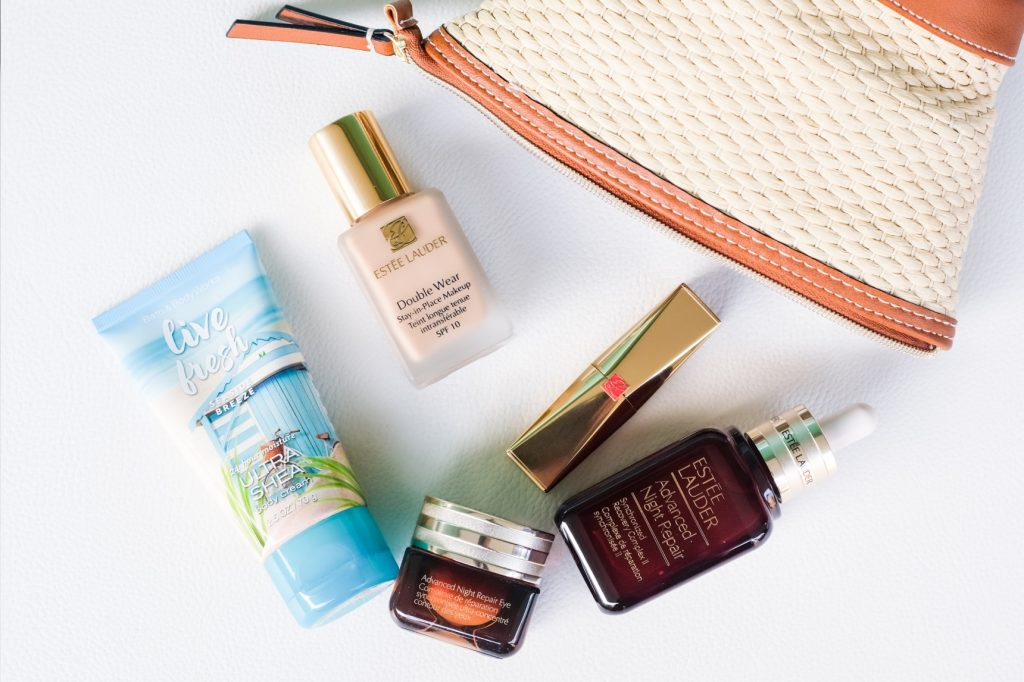 A peek into Nurul Aini's makeup pouch — Bath & Body Works' Live Fresh Ultra Shea body moisturiser; Estee Lauder's Advanced Night Repair serum for the face (S$175) and eyes (S$104).