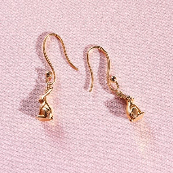 A pair of dangling bunny hook earrings in 18-carat gold, available at S$2,350.