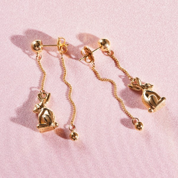 A pair of dangling bunny stud earrings with chains in 18-carat gold, available at S$3,820.