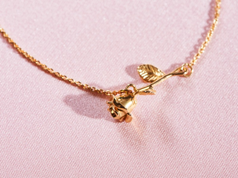 A rose pendant in 18-carat gold, available at S$1,640.