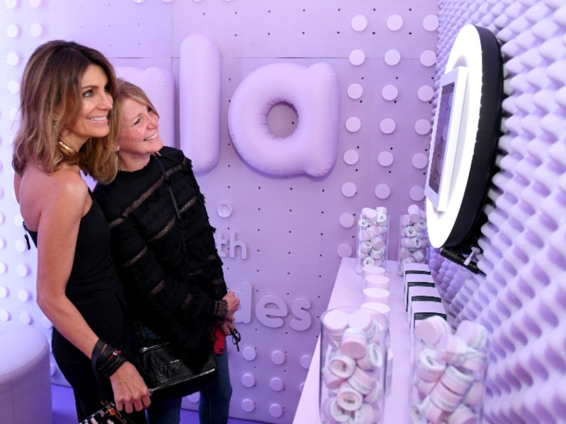 Tiffany Masterson (left) posing for a shot in the Lala Retro Whipped Cream photo booth. Image courtesy of Drunk Elephant